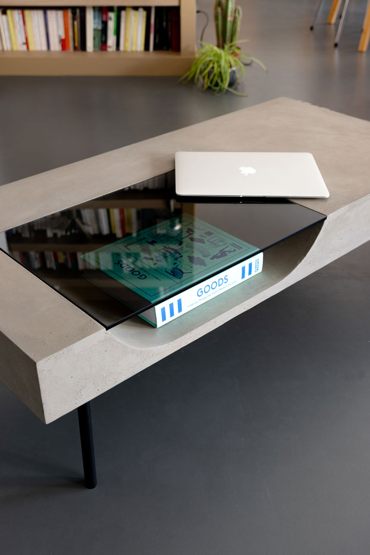 curb concrete coffee table with tinted glass niche